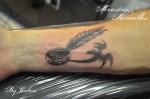 Tatouage anneau et dragon