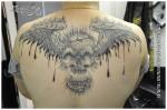 Tatouage de crâne ailé